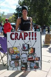 Kerri Kellerman holds a sign displaying her feelings about the media.