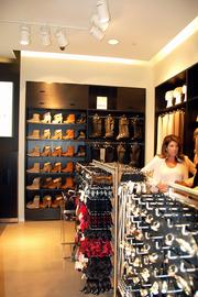 Shoes, shoes and more shoes — and boots, too, at the new H&M store in the Denver Pavilions.