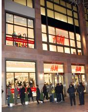Guests for H&M's Nov. 9 pre-opening celebration lined up around the block at the Denver Pavilions. Some were still waiting as late as 9 p.m. to get in and do some shopping.