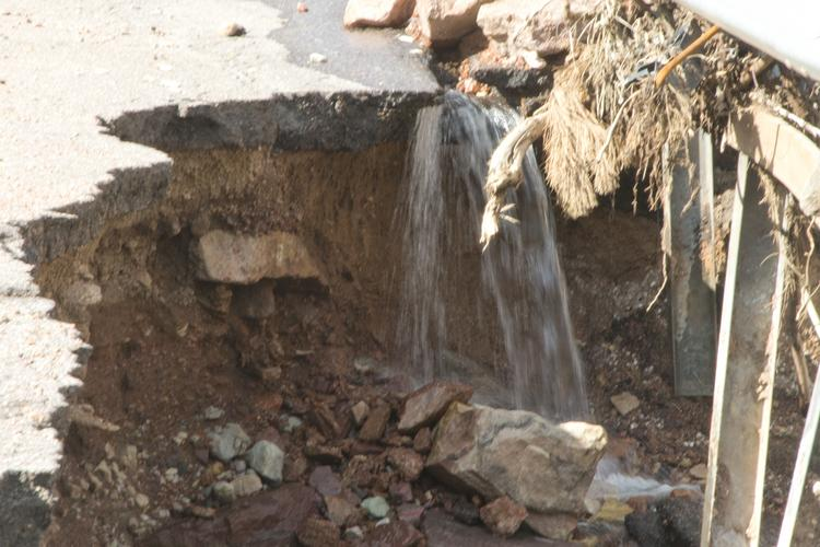 Roads were badly damaged in Manitou Springs by flooding.