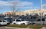 Shoppers crowd into the parking lot at Centennial Promenade shopping center in Centennial.