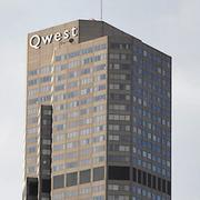 The former Qwest sign on its headquarters tower in downtown Denver