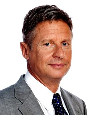 During Wednesday's presidential debate, Libertarian Party presidential nominee Gary Johnson sat in what looked like a hotel room and offered running online commentary on Google+Hangout and Twitter.