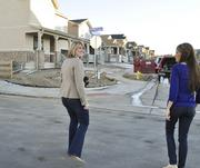 Lyndi Martoia, real estate agent for 8Z, walks client Alyce Carron to her newly built home in Village of Five Parks in Arvada.