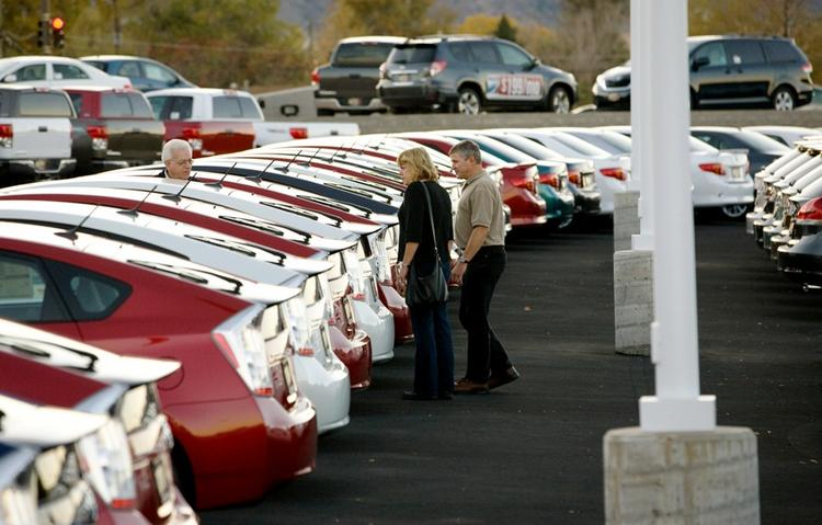 Stan Hoffman, salesman at Stevinson Toyota West in Lakewood, helps a couple looking at new Toyotas (2010 photo).