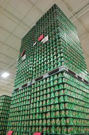 Pallets of newly made empty cans at Ball Metal Container Group in Golden.