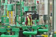 A contractor works in the End department at Ball Metal Beverage Container in Golden.