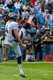 Denver Broncos punter Britton Colquitt kicks during a Nov. 11, 2012, game against the Carolina Panthers in Charlotte.