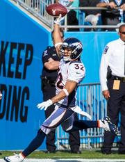 Denver Broncos cornerback Tony Carter scores a touchdown after an  interception during a Nov. 11, 2012, game vs. the Carolina Panthers in  Charlotte.