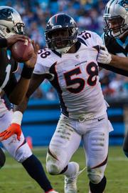 Denver Broncos linebacker Von Miller gets to the passer during a Nov. 11, 2012, game vs. the Carolina Panthers in Charlotte. Miller will sit out the first six games of the 2013 season under an NFL suspension.