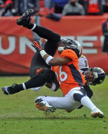 Ravens tight end Dennis Pitta is tackled by Broncos safety Rahim Moore during Saturday's thrilling AFC divisional game. The Ravens won the game 38-35 in double overtime.