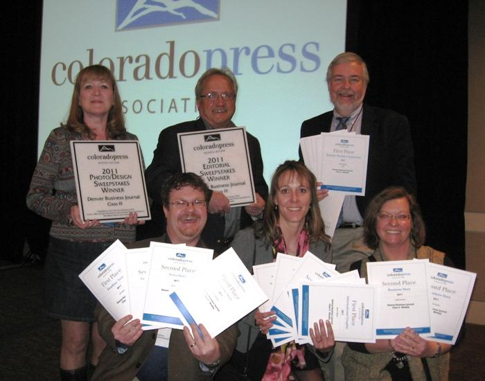 Denver Business Journal staffers display awards from the Colorado Press Association at its Better Newspaper Contest luncheon Saturday, Feb. 25. Pictured: At top, Associate Editor Boots Gifford, Editor Neil Westergaard, New Media Editor Mark Harden. At bottom: Reporter Ed Sealover, photographer Kathleen Lavine, reporter Cathy Proctor.