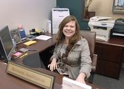 Bronwen Anufrijevas, senior branch office administrator at Edward Jones, greets people with a smiling face at the 277 Broadway location.