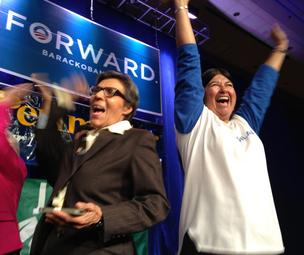 At the Colorado Democrats' election-night party at the Sheraton Downtown Denver, Colorado state Sens. Lucía Guzmán and Irene Aguilar celebrate as word spreads that the networks called the election for President Barack Obama.