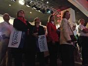 Partygoers watch results come in at the GOP election night gathering at Sports Authority Field at Mile High.