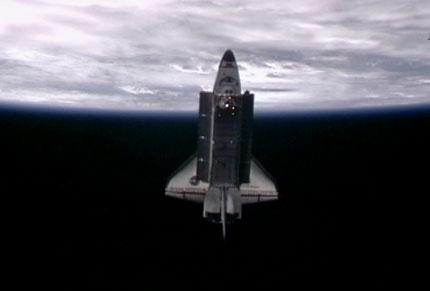 A video camera on the exterior of the International Space Station captured this image of space shuttle Endeavour a little less than an hour after the two spacecraft undocked.