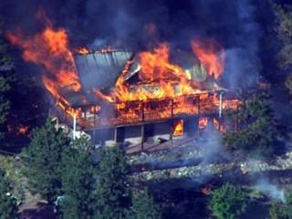 A home burns in the Lower North Fork fire in the foothills of Jefferson County near Conifer, as seen from CBS4's Copter4. (Photo: CBS4)