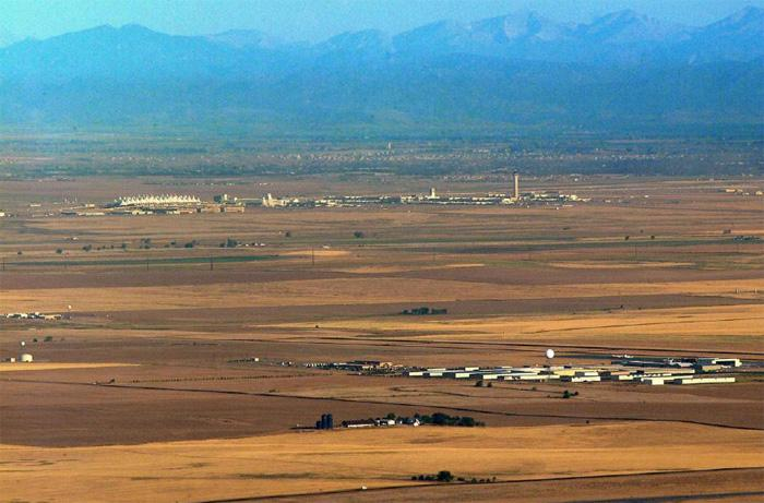 Front Range Airport (foreground) is six miles from Denver International Airport (middle ground).
