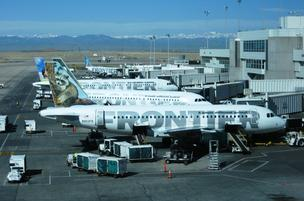 Frontier Airlines jets at Denver International Airport.