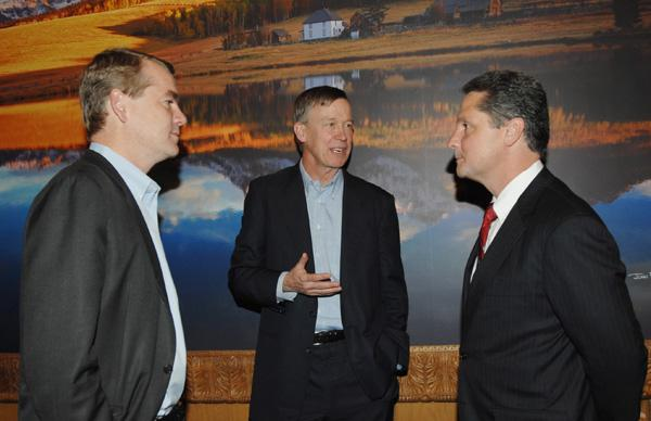 From left: U.S. Sen. Michael Bennet; Colorado Gov. John Hickenlooper; and Vic Abate, General Electric's vice president of renewable energy, confer about GE's new Colorado solar plant in a briefing at Hickenlooper's office on Friday, Oct. 14.