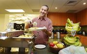 Greg Greenstreet, vice president of engineering at GNIP in Boulder, fills his plate where free breakfast is offered every day.