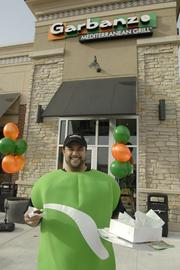 Kevin Rendon, catering coordinator, dresses the part (as a bean) at the soft opening at Garbanzo Mediterranean Grill at Promenade at Denver West