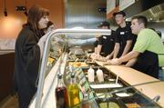 Customers order at the soft opening of the Garbanzo Mediterranean Grill in Denver West in Lakewood.