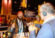 Jason Yester, head brewer at Trinity Brewing Co. of Colorado Springs, is  interviewed at Trinity's booth at the Great American Beer Festival shortly after  winning a bronze medal in the American-style Brett ale category for his TPS  Report.