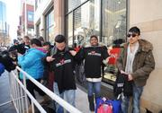 Alec Schade, Imani Swait and Tony Saucedo are near the front of the line at H&M's grand opening in Denver Pavilions, where they received t-shirts.