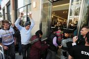 People are let into the store at noon at H&M's grand opening in Denver Pavilions Thursday.
