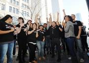 H&M staff cheer as the grand opening of the store takes place in Denver Pavilions Thursday.