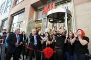 H&M staff, including the chain's U.S. president, Daniel Kulle (far left behind ribbon) and Jeremy DeCola, store manager (in front with arms up), get ready to cut the ribbon for H&M's grand opening in Denver Pavilions Thursday, Nov. 10, at noon.