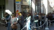 H&M customers line up shortly after noon.