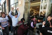 People are let into the store at H&M's grand opening in Denver Pavilions Thursday, Nov. 10, at noon. November 2011