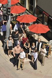 IMA Financial Group ranked No. 1 in the medium-size business category. The employees of IMA seen here taking a group walk, can earn points for participating in the the company's wellness programs. The points can be redeemed for a discount of up to $363 annually on health care premiums.