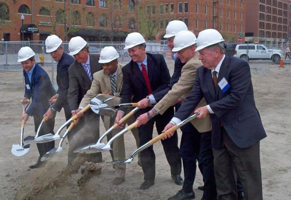 Denver Mayor Michael Hancock (fourth from left), IMA Financial CEO Rob Cohen (ftfth from left) and Colorado Gov. John Hickenlooper (sixth from left, partially obscured) were among business leaders and officials on hand for the groundbreaking ceremony at the site of IMA Financial Group's headquarters building near Denver Union Station on Wednesday, April 11, 2012. [Scott Bemis | Denver Business Journal]