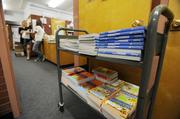 KPMG volunteers will hand out two books to each student at Barrett Elementary. KPMG has fundraisers throughout the year in order to buy the books they hand out.