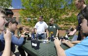 """KPMG volunteers for Earth Day at Sandoval Elementary School helping the kids plant seeds in an effort to teach the """"cycle of life"""". Left to right from KPMG, Mike Bearup, Erin Casey and Matt Blei from KPMG."""
