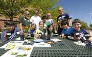 """KPMG volunteers for Earth Day at Sandoval Elementary School helping the kids plant seeds in an effort to teach the """"cycle of life"""". Left to right from KPMG, Erin Casey, Mike Bearup, Angela Coleman and Matt Blei from KPMG."""