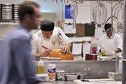 Chance Savell, lead banquet cook at the Grand Hyatt, carves a pumpkin.