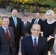 From Wealth Concepts: Scott Stillman (center), president, and left to right behind him are Dustin Voag, director of financial planning; Scott Close, associate managing director; Howard Schuster, director of investments; Tyler Rainey, director of brokerage; and Melissa Edelman, managing director.