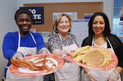 Traci Jones, marketing specialist, Robyn Fleischman, executive assistant and Doris Lane, executive assistant at Comcast, make pancakes at a breakfast benefiting Mile High United Way.