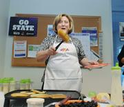 Robyn Fleischman,  executive assistant at Comcast, flips pancakes for a breakfast benefiting Mile High United Way .