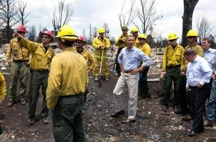 President Barack Obama views fire damage with firefighters in Colorado Springs on Friday, June 29, 2012. (Photo: White 