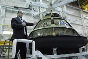 Jim Bray, crew and service module director for Lockheed Martin Space Systems, shows off the Orion space capsule at the company's Waterton Canyon site, March 21, 2011.