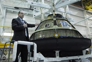 Jim Bray, Orion director for Lockheed Martin Space Systems Co., explains the heat shield and protective tiles that will go on the space capsule being built for NASA during an event last month at the company's Jefferson County facility.