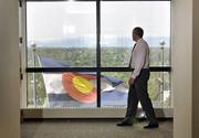 Ballard Pritchett, VP, Strategic Communications at Colorado Access (a health plan provider), walks by the Colorado flag as it blows in the wind outside his office. Changes in health care were predominant in the past year.June 2012