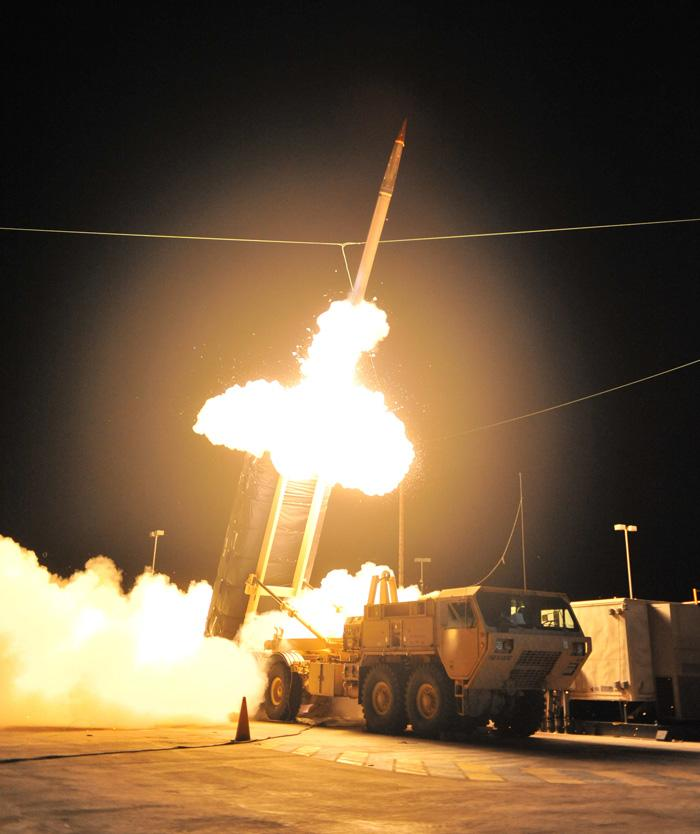 A Terminal High Altitude Area Defense (THAAD) interceptor is launched during the system's first operational test Oct. 5, 2011, at the Pacific Missile Range Facility in Hawaii. During the test the THAAD system simultaneously intercepted two ballistic missile targets.