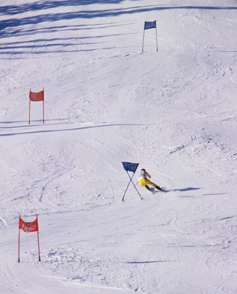 A slalom skier races at the 1994 Winter Olympics in Lillehammer, Norway.