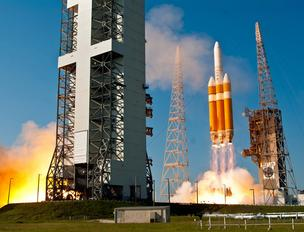 A ULA Delta IV Heavy rocket lifts off from Cape Canaveral Air Force Station, Fla.,  carrying a secret payload for the National Reconnaissance Office on Friday, June 29, 2012.
